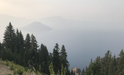 evening view of Crater Lake during wildfires